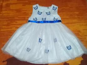 Нарядное платье с бабочками.