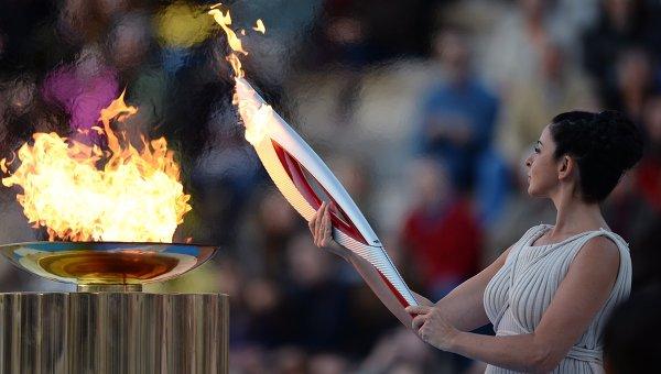 про олимпийский огонь...