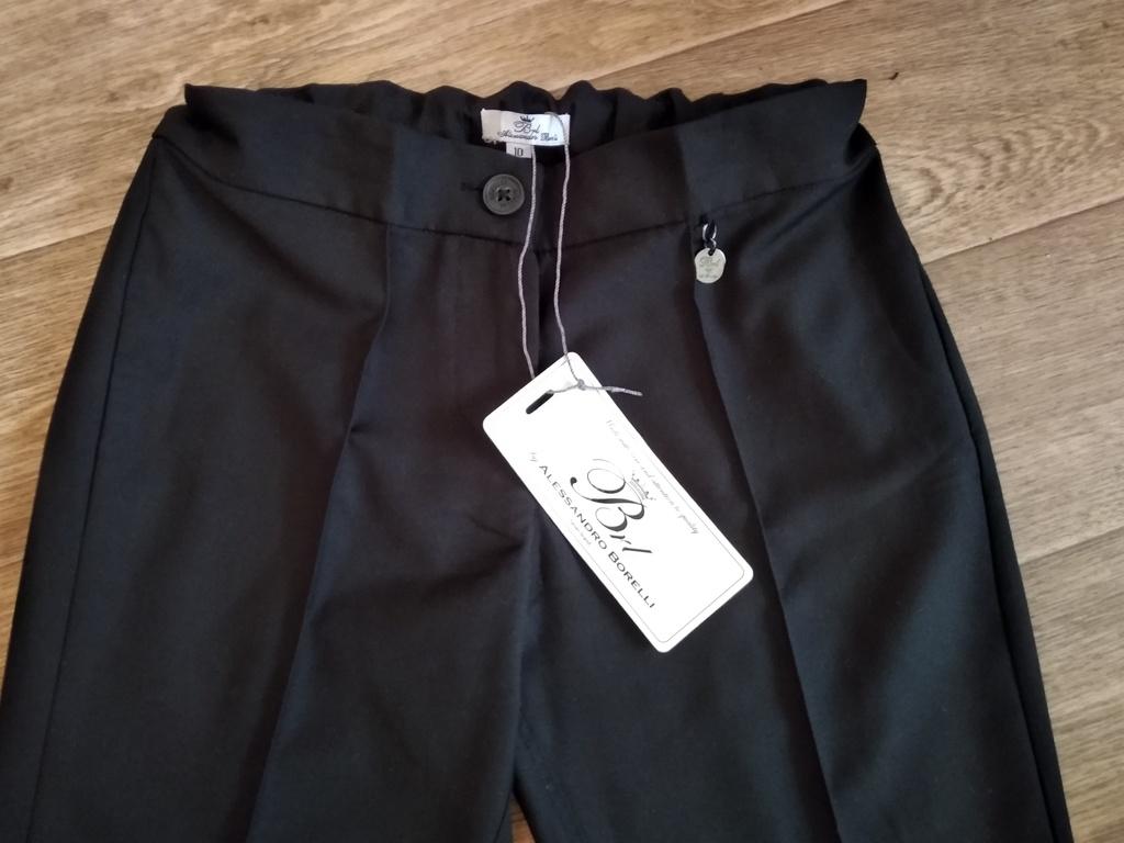 Две блузки и новые брюки Borelli на 9-10л.пакетом