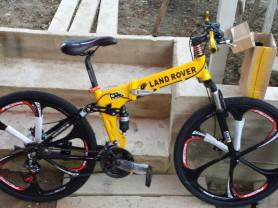 Велосипед желтый Land Rover складной на литых дисках