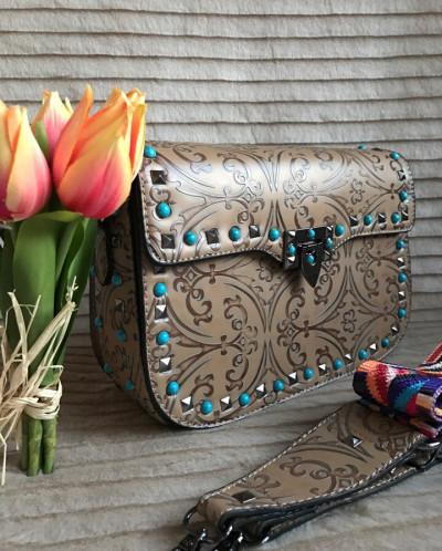 Культовые сумочки Valentino с шипами