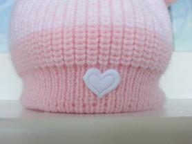 Теплая шапочка для новорожденной малышки